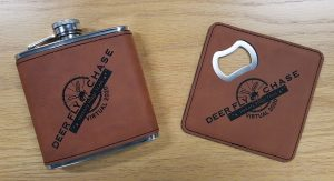 Flask and bottle opener coaster with the Deer Fly Chase logo